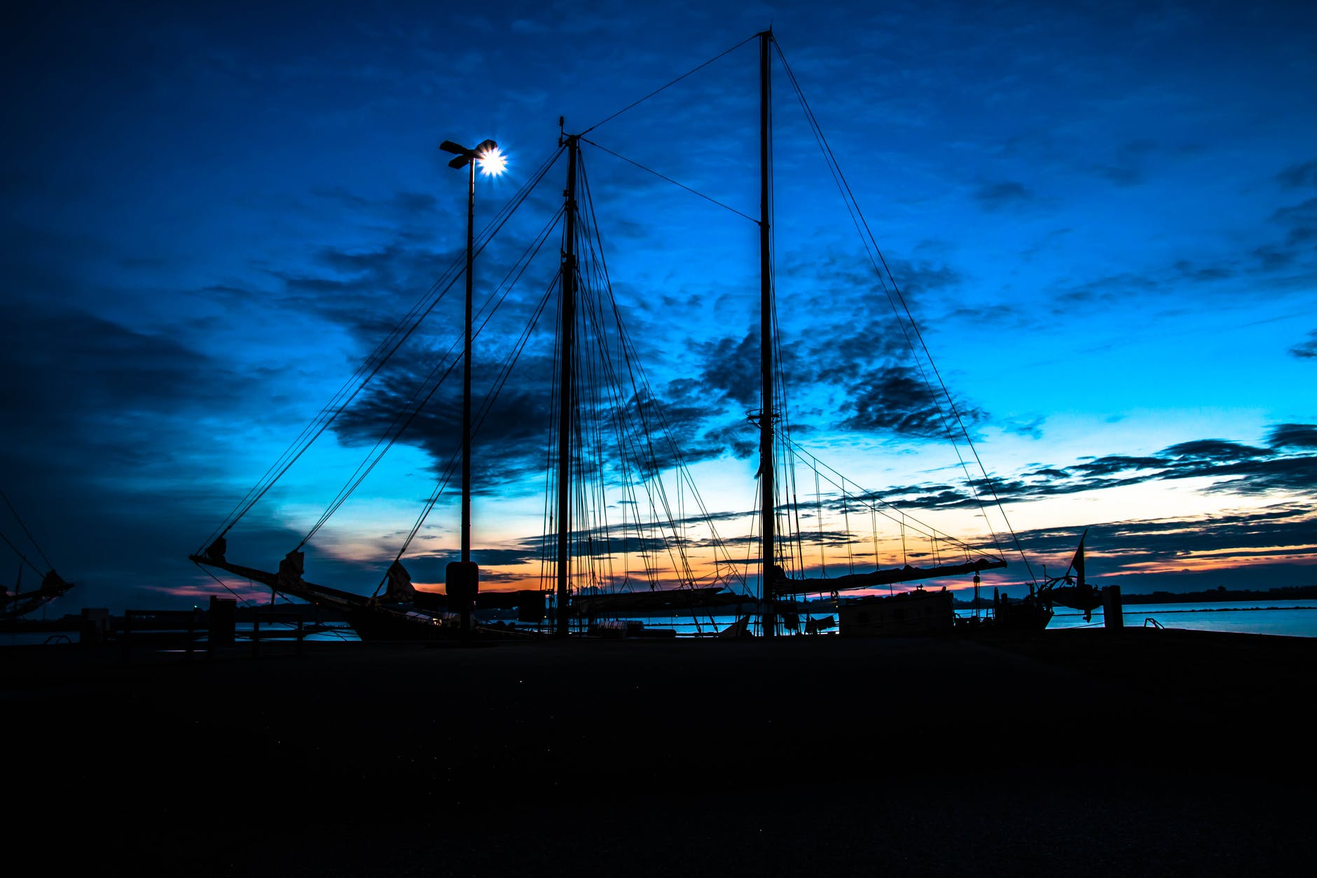 silhouette photo of black sailing ship